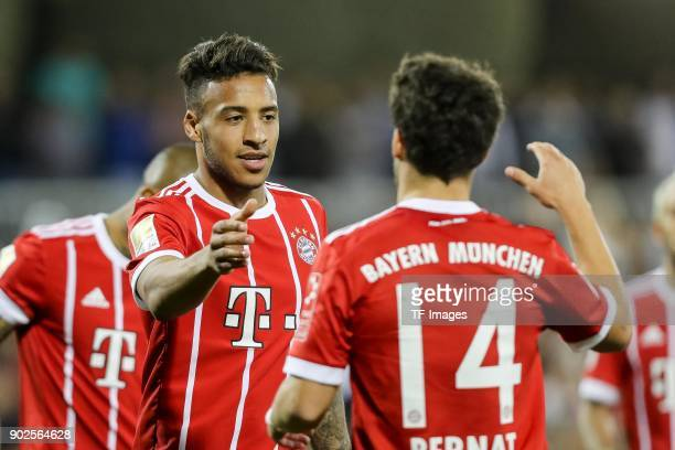 Corentin Tolisso of Muenchen celebrates after scoring his team`s second goal with team mates during the Friendly match between AlAhli and Bayern...