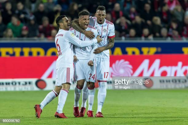 Corentin Tolisso of Muenchen celebrates after scoring his team`s second goal with team mates during the Bundesliga match between SportClub Freiburg...