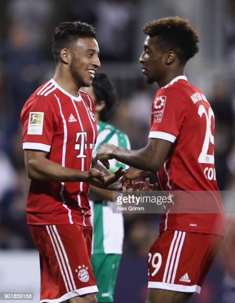 Corentin Tolisso of Muenchen celebrates his team's second goal with team mate Kingsley Coman during the friendly match between AlAhli and Bayern...
