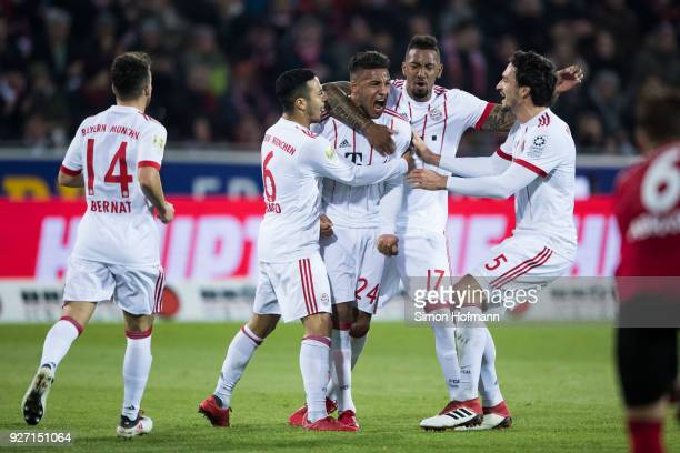 Corentin Tolisso of Muenchen celebrates his team's second goal with team mates Jerome Boateng Mats Hummels and Thiago during the Bundesliga match...