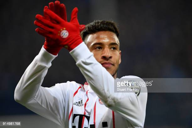 Corentin Tolisso of Muenchen celebrates victory after the DFB Cup quarter final match between SC Paderborn and Bayern Muenchen at Benteler Arena on...