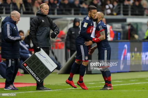 Corentin Tolisso of Muenchen comes on as a substitute for Arturo Erasmo Vidal of Muenchen during the Bundesliga match between Eintracht Frankfurt and...