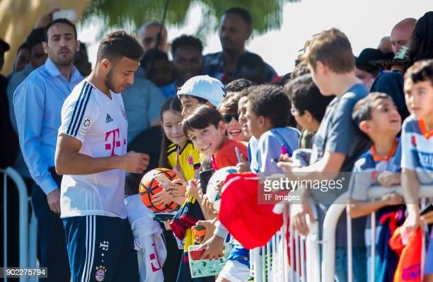 Corentin Tolisso of Muenchen gives autographs during the FC Bayern Muenchen training camp at Aspire Academy on January 06 2018 in Doha Qatar