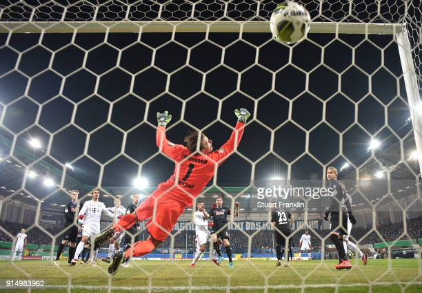 Corentin Tolisso of Muenchen scores the fourth goal during the DFB Pokal quater final match between SC Paderborn and Bayern Muenchen at Benteler...