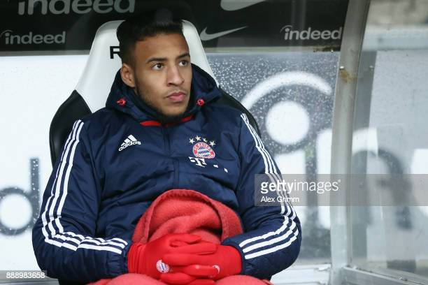 Corentin Tolisso of Muenchen sits on the bench prior to the Bundesliga match between Eintracht Frankfurt and FC Bayern Muenchen at CommerzbankArena...