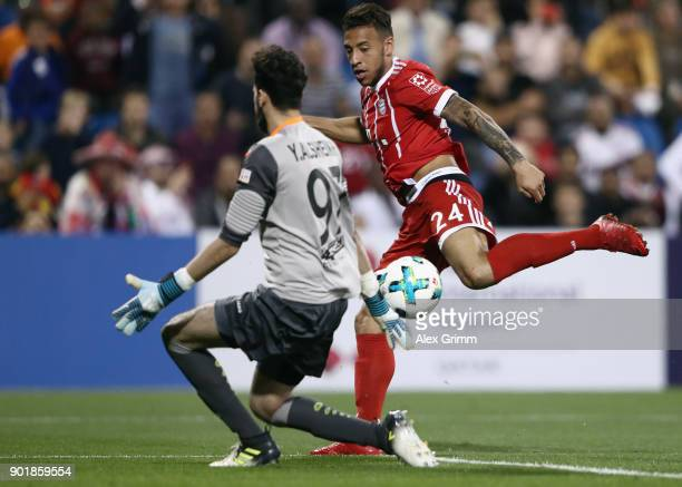 Corentin Tolisso of Muenchen tries to score against goalkeeper Alsheik of Al Ahli during the friendly match between AlAhli and Bayern Muenchen on day...