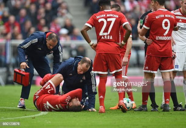 Corentin Tolisso of Munich is injured during the German Bundesliga soccer match between FC Bayern Munich and Hamburger SV at the Allianz Arena in...
