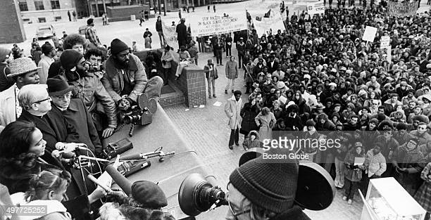Coretta King left speaks to encourage integration at schools during a rally at City Hall Plaza in Boston on Nov 30 1974 An initiative to desegregate...