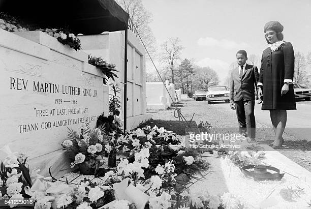 Coretta Scott King and her son Dexter visit the grave of Martin Luther King Jr one year after his assassination