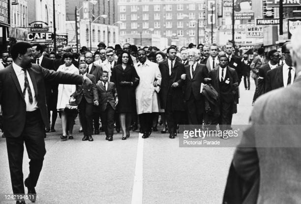 Coretta Scott King leads thousands of protestors through Memphis, Tennessee, in support of the city's striking sanitation workers, 8th April 1968....