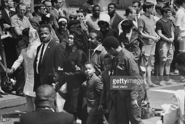 Coretta Scott King widow of assassinated American civil rights leader Martin Luther King Jr and her children in her late husband's funeral procession...