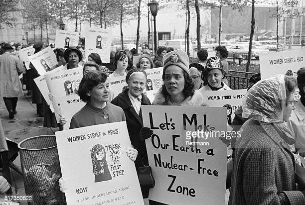 Coretta Scott King , wife of civil rights leader Martin Luther King Jr., joins Women Strike for Peace founder Dagmar Wilson in a march on the United...