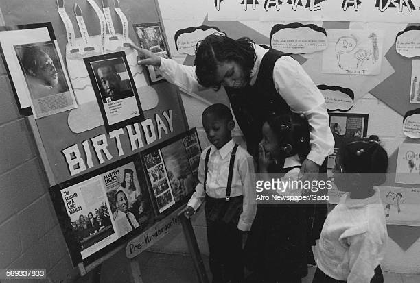 Coretta Scott King with two AfricanAmerican youths 1995