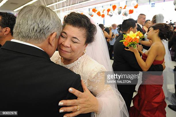 Corey Aldridge and Gwen Whitmore dance after their 99 cent wedding ceremony at the 99 cent store in Los Angeles on September 9 2009 The budget...