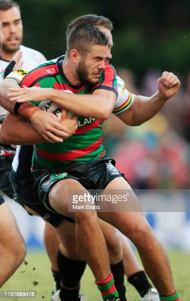 Corey Allan of Souths is tackled during the NRL trial match between the South Sydney Rabbitohs and the Penrith Panthers at Redfern Oval on February...