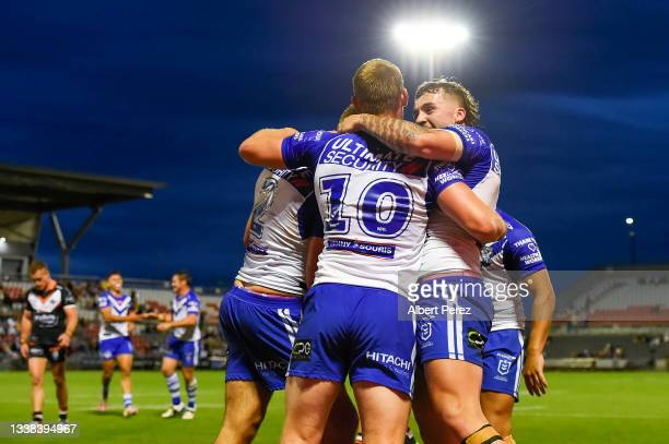 Corey Allan of the Bulldogs celebrates with team mates after scoring a try during the round 25 NRL match between the Wests Tigers and the Canterbury...