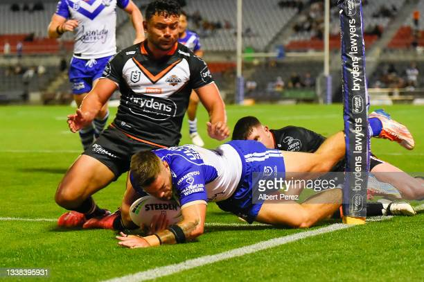 Corey Allan of the Bulldogs scores a try during the round 25 NRL match between the Wests Tigers and the Canterbury Bulldogs at Moreton Daily Stadium,...