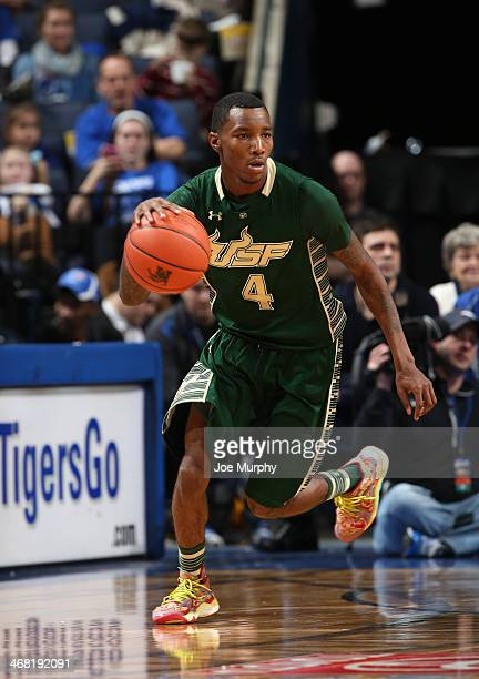 Corey Allen Jr #4 of the USF Bulls dribbles the ball against the Memphis Tigers on January 26 2014 at FedExForum in Memphis Tennessee Memphis beat...