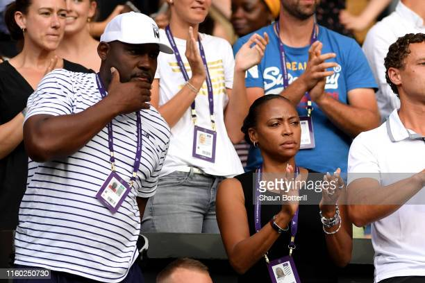 Corey and Candi Gauff parents of Cori Gauff of The United States celebrate her winning the second set in her Ladies' Singles third round match...