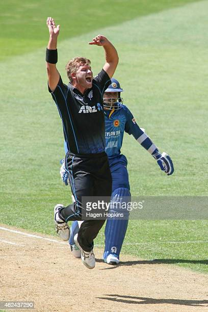 Corey Anderson of New Zealand appeals successfully for the wicket of Lahiru Thirimanne of Sri Lanka while Tillakaratne Dilshan looks on during the...