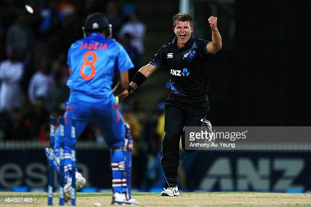 Corey Anderson of New Zealand celebrates after taking the wicket of Ravindra Jadeja of India during the One Day International match between New...