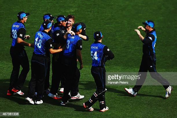 Corey Anderson of New Zealand celebrates the wicket of Rilee Rossouw of South Africa with Martin Guptill of New Zealand during the 2015 Cricket World...