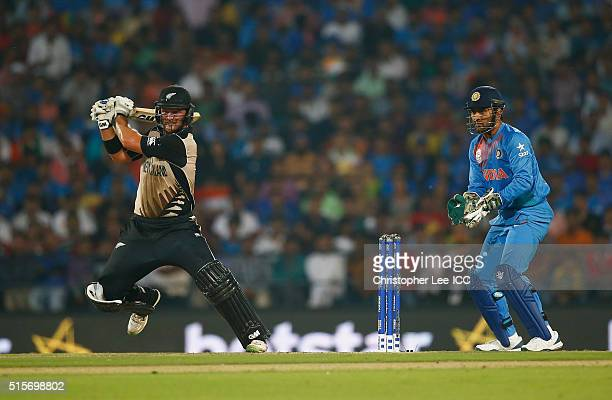 Corey Anderson of New Zealand i action with MS Dhoni of India during the ICC World Twenty20 India 2016 Group 2 match between New Zealand and India at...