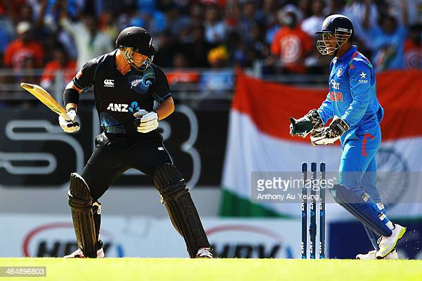Corey Anderson of New Zealand looks at the stumps after being bowled by Ravichandran Ashwin of India as MS Dhoni starts to celebrate during the One...