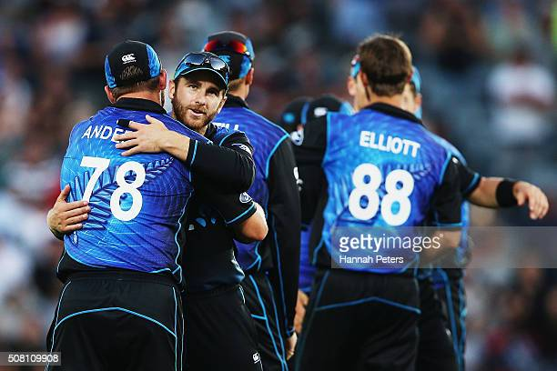 Corey Anderson of the Black Caps celebrates with Kane Williamson of the Black Caps after winning the One Day International match between New Zealand...