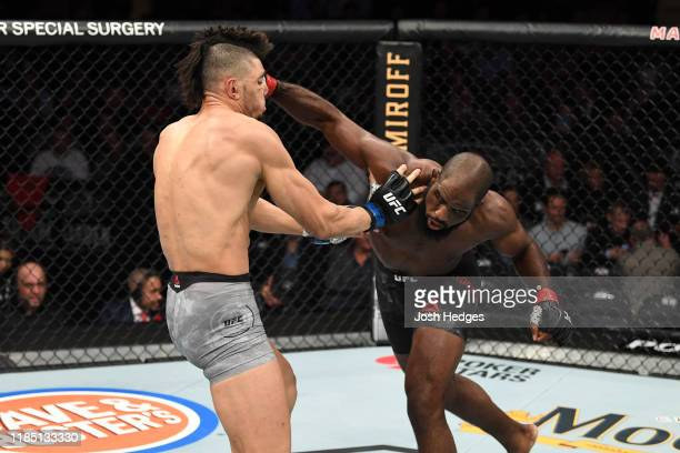 Corey Anderson punches Johnny Walker of Brazil in their light heavyweight bout during the UFC 244 event at Madison Square Garden on November 02, 2019...
