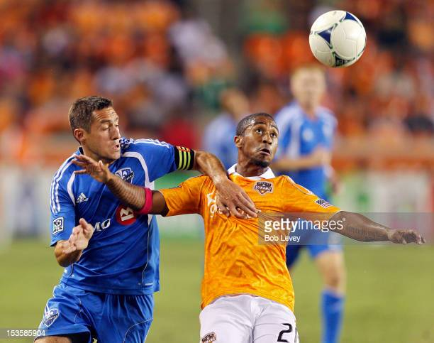 Corey Ashe of the Houston Dynamo and Davy Arnaud of the Montreal Impact fight for possesion at BBVA Compass Stadium on October 6, 2012 in Houston,...