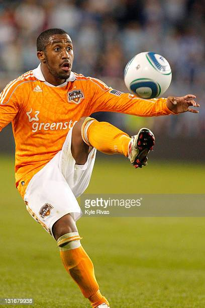 Corey Ashe of the Houston Dynamo gains control of a lose ball against Sporting Kansas City in the second half during the MLS Eastern Conference...