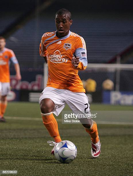 Corey Ashe of the Houston Dynamo plays the ball against the New York Red Bulls at Giants Stadium in the Meadowlands on May 16 2009 in East Rutherford...