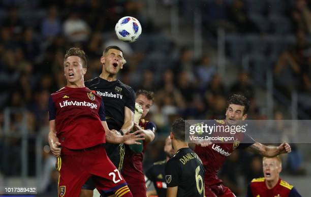 Corey Baird of Real Salt Lake and Christian Ramirez of Los Angeles FC vie for the ball into the goal box from a corner kick during the second half of...