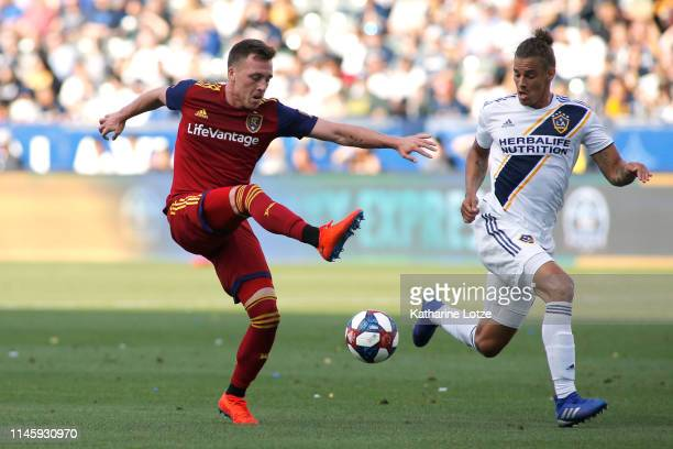 Corey Baird of Real Salt Lake kicks the ball as Rolf Feltscher of Los Angeles Galaxy defends during a game at Dignity Health Sports Park on April 28...
