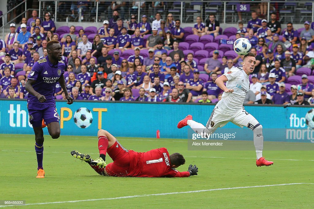 ORLANDO, FL - MAY 06 Corey Baird #27 of Real Salt Lake scores a goal past a diving Joseph Bendik #1 of Orlando City SC during a MLS soccer match at Orlando City Stadium on May 6, 2018 in Orlando, Florida.