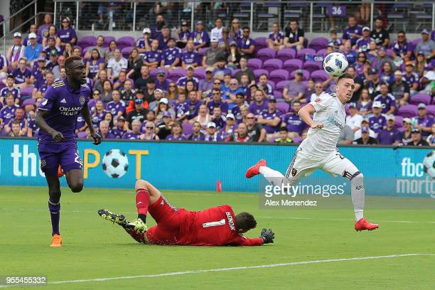 ORLANDO FL MAY 06 Corey Baird of Real Salt Lake scores a goal past a diving Joseph Bendik of Orlando City SC during a MLS soccer match at Orlando...