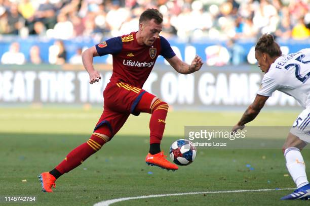 Corey Baird of Real Salt Lake takes the ball down the field as Rolf Feltscher of Los Angeles Galaxy tries to block during the first half of a game at...