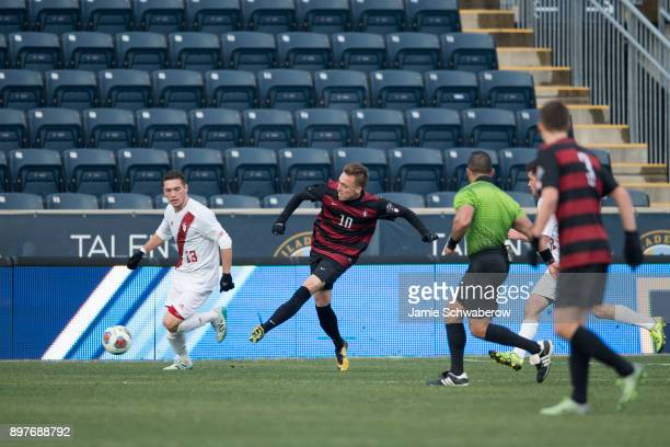 Corey Baird of Stanford University assists on the game winning goal against Indiana University during the Division I Men's Soccer Championship held...