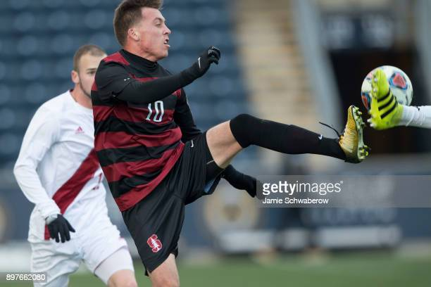 Corey Baird of Stanford University stretches for the ball against Indiana University during the Division I Men's Soccer Championship held at Talen...