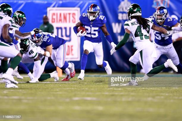 Corey Ballentine of the New York Giants carries the ball during the second quarter of a preseason game against the New York Jets at MetLife Stadium...