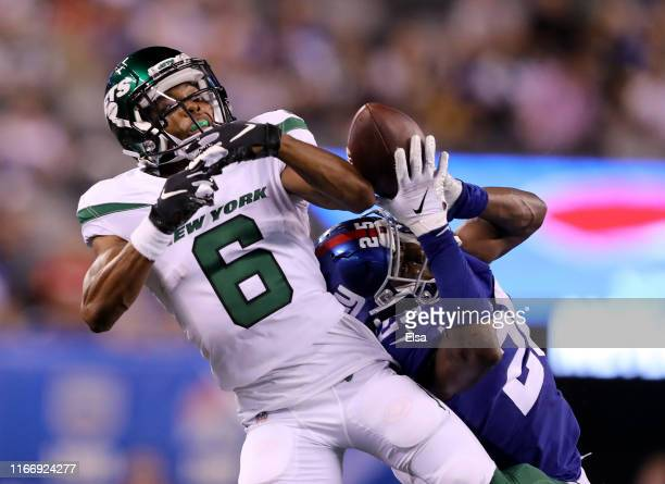Corey Ballentine of the New York Giants picks off a pass intended for Tim White of the New York Jets in the second half during a preseason matchup at...