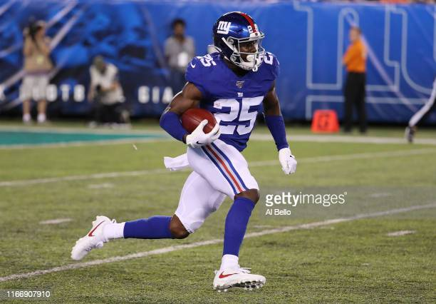 Corey Ballentine of the New York Giants returns a kickoff against the New York Jets during their Pre Season game at MetLife Stadium on August 08 2019...