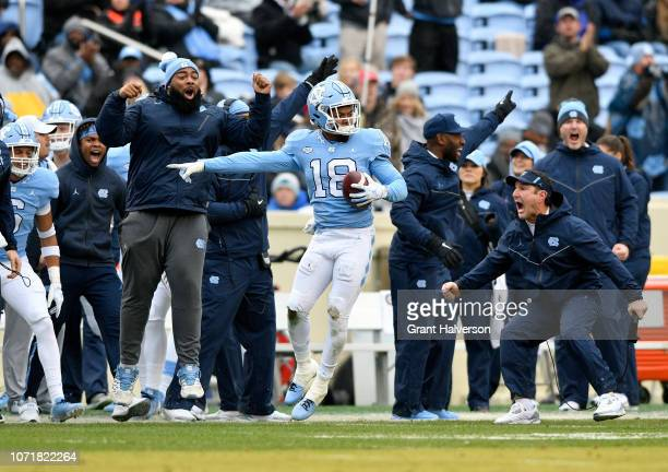 Corey Bell Jr #18 of the North Carolina Tar Heels reacts after intercepting a pass against the North Carolina State Wolfpack during the first half of...