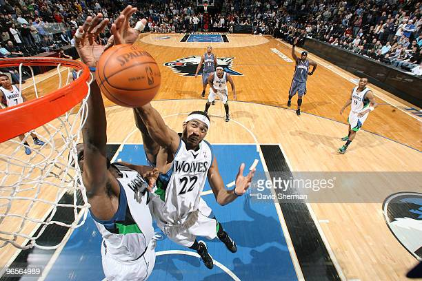 Corey Brewer and Al Jefferson of the Minnesota Timberwolves go for the rebound during the game against the Charlotte Bobcats on February 10 2010 at...