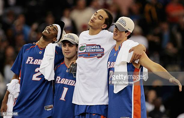 Corey Brewer Brett Swanson Joakim Noah and Jack Berry of the Florida Gators celebrate after defeating the UCLA Bruins 7357 during the National...
