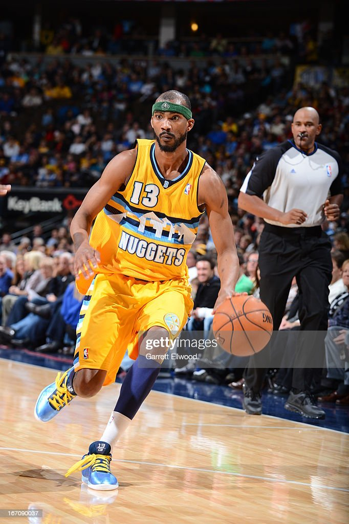 Corey Brewer #13 of the Denver Nuggets dribbles the ball up the floor against the Houston Rockets on April 6, 2013 at the Pepsi Center in Denver, Colorado.