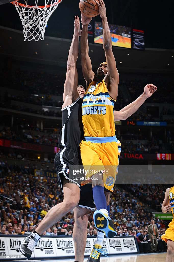 Corey Brewer #13 of the Denver Nuggets dunks the ball against the Brooklyn Nets on March 29, 2013 at the Pepsi Center in Denver, Colorado.