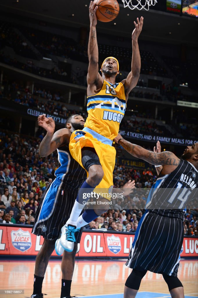 Corey Brewer #13 of the Denver Nuggets goes to the basket during the game between the Orlando Magic and the Denver Nuggets on January 9, 2013 at the Pepsi Center in Denver, Colorado.