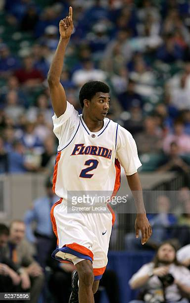 Corey Brewer of the Florida Gators celebrates a threepoint shot in the second half of the game against the Mississippi State Bulldogs during the...